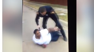 An image from a Facebook video showing a woman being arrested in Fort Worth, Texas in Dec. 2016. (Credit: Porsha Carver/Facebook)