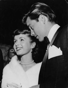 Actors Debbie Reynolds and Robert Wagner are pictured at a party in Hollywood, circa 1959. (Credit: Keystone/Hulton Archive/Getty Images)