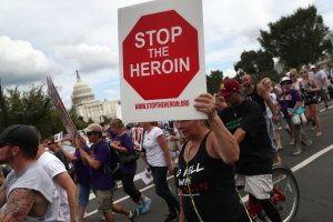 Activists and family members of loved ones who have died from opioid abuse march in a rally at Capitol Hill on Sept. 18, 2016. (Credit: John Moore / Getty Images)
