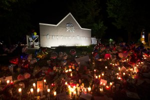 Candles are lit in front of the Cascade Mall on Sept. 26, 2016, in Burlington, Washington. (Credit: Karen Ducey / Getty Images)