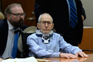 Attorney Chip Lewis is seated close behind New York real estate heir Robert Durst, at the Airport Branch of the Los Angeles County Superior Court on Nov. 7, 2016 for his trial in which he's pleaded not guilty to the December 2000 murder of his friend Susan Berman. (Credit: Kevork Djansezianv / AFP / Getty Images)