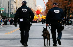 NYPD officers patrol the street as people arrive to watch the 90th Macy's Annual Thanksgiving Day Parade on November 24, 2016 in New York City. (Credit: Eduardo Munoz Alvarez/Getty Images)