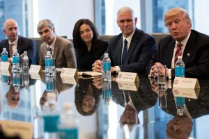 Jeff Bezos, chief executive officer of Amazon, Larry Page, chief executive officer of Google's parent company Alphabet Inc., Sheryl Sandberg, chief operating officer of Facebook, and Vice President-elect Mike Pence listen as President-elect Donald Trump speaks during a meeting of technology executives at Trump Tower, Dec. 14, 2016, in New York City. (Credit: Drew Angerer/Getty Images)