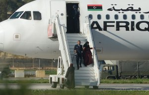 A picture taken on December 23, 2016 in Valletta, Malta, shows a crew member helping hostages to disembark from the Afriqiyah Airways A320 after it was hijacked from Libya. (Credit: MATTHEW MIRABELLI/AFP/Getty Images)