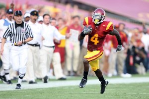 Joe McKnight, No. 4 of the USC Trojans, rushes the ball during a game at the Los Angeles Memorial Coliseum against the Ohio State Buckeyes on Sept. 13, 2008 in Los Angeles. (Credit: Harry How/Getty Images)
