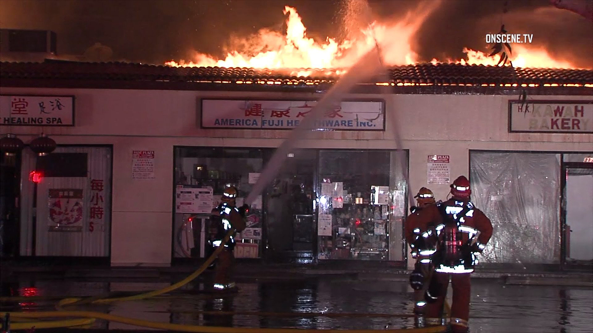 Firefighters battle a blaze at a strip mall in Monterey Park on Dec. 15, 2016. (Credit: OnScene.TV)