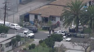 Authorities on scene at Jackie Rogers' Lennox home, where they believe he killed Lisa