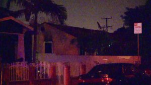 A Paramount home is damaged by fire after a man fought with deputies there on Dec. 1, 2016. (Credit: KTLA)