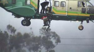 A woman is rescued from the San Gabriel River on Dec. 16, 2016. (Credit: KTLA)