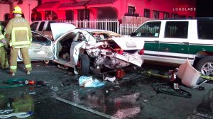 A car that was slammed from behind by a suspected DUI driver in South Los Angeles on Dec. 2, 2016 sustained major damage. (Credit: LOUDLABS)