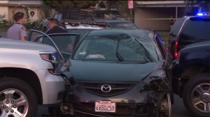 The suspects' car is shown after it had come to a halt in Tustin on Dec. 14, 2016. (Credit: KTLA)