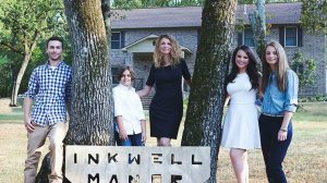 Cara Brookins and her four children stand in front of the home they built. (Credit: Cara Brookins via CNN)