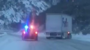 CHP Truckee posted Facebook video of a FedEx truck sliding down I-80 on Jan. 12, 2017.