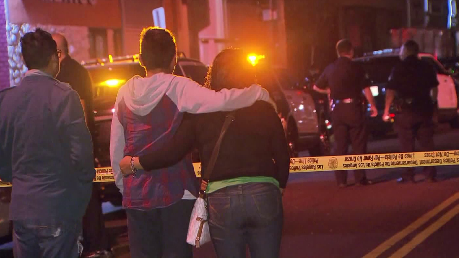People gather after a fatal hit-and-run in the Fashion District on Nov. 11, 2016. (Credit: KTLA)