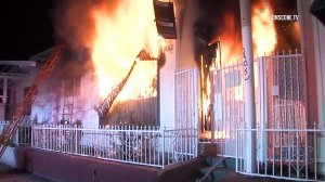 Four children were critically injured when a fire broke out in the 800 block of West Manchester Avenue in South Los Angeles on Jan. 16, 2017. (Credit: OnScene.TV)