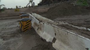 Mud cakes a street in Duarte on Jan. 22, 2017 after heavy rain pounded the Fish Fire burn area. (Credit: KTLA)