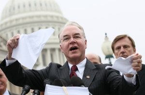 Rep. Tom Price, R-Georgia, tears a page from the national health care bill during a press conference at the U.S. Capitol March 21, 2012 in Washington, DC.  (Credit: Win McNamee/Getty Images)
