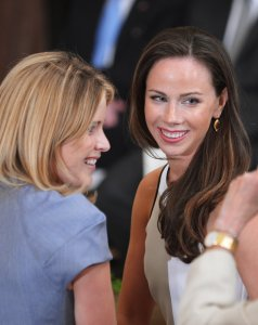 Jenna Bush-Hager, left, and Barbara Bush, the daughters of former U.S. president George W. Bush and his wife Laura Bush, are seen during the official portrait unveiling of their parents May 31, 2012 in the East Room of the White House in Washington, DC. (Credit: Mandel Ngan / AFP / GettyImages)