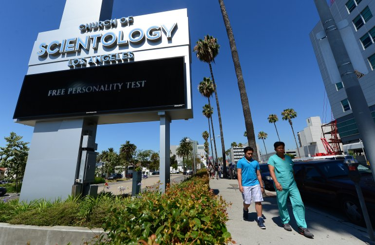 Pedestrians walk past the Church of Scientology along Sunset Boulevard in Hollywood on July 9, 2012. (Credit: FREDERIC J. BROWN/AFP/GettyImages)