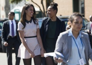 Malia Obama, left, and Sasha Obama, U.S. President Barack Obama's daughters, arrive for an event marking the 50th Anniversary of the Selma to Montgomery civil rights marches at the Edmund Pettus Bridge in Selma, Alabama, on March 7, 2015. (Credit: Saul Loeb / AFP / Getty Images)