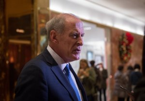 Dan Coats speaks to the media in the lobby of Trump Tower, November 30, 2016 in New York, after meetings with US President-elect Donald Trump. (Credit: BRYAN R. SMITH/AFP/Getty Images)