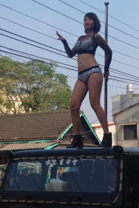 This picture taken on Jan. 3, 2017, shows a pole dancer performing on top of a jeep during the funeral procession of former Chiayi City county council speaker Tung Hsiang in Chiayi City, southern Taiwan. (Credit: STR / AFP / Getty Images)