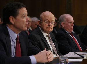 FBI Director James Comey, Director of National Intelligence James Clapper and  CIA Director John Brennan, left to right, testify before the Senate (Select) Intelligence Committee in the Dirksen Senate Office Building on Capitol Hill Jan. 10, 2017. (Credit: Joe Raedle/Getty Images)