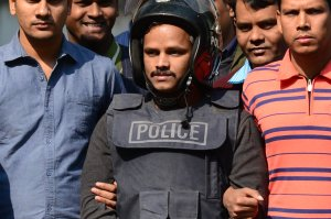 Bangladesh police escort alleged Islamist militant Jahangir Alam (C) in Dhaka on Jan. 14, 2017, after his arrest in connection with an attack on the Holey Artisan Bakery attack last year. (Credit: STR/AFP/Getty Images)