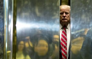 U.S. President-elect Donald Trump boards the elevator after escorting Martin Luther King III to the lobby after meetings at Trump Tower in New York City on Jan. 16, 2017. (Credit: Dominick Reuter / AFP / Getty Images)