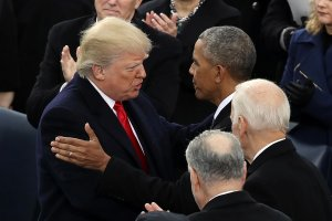 Former U.S. President Barack Obama (R) congratulates U.S. President Donald Trump after he took the oath of office on the West Front of the U.S. Capitol on Jan. 20, 2017 in Washington, DC. (Credit: Drew Angerer/Getty Images)