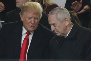 U.S. President Donald Trump and Defense Secretary Gen. James Mattis watch the Inaugural Parade from the main reviewing stand in front of the White House on Jan. 20, 2017. (Credit: Patrick Smith/Getty Images)