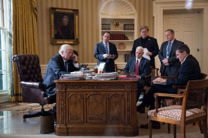 President Donald Trump speaks on the phone with Russian President Vladimir Putin in the Oval Office of the White House, Jan. 28, 2017 in Washington, DC. Also pictured, from left, White House Chief of Staff Reince Priebus, Vice President Mike Pence, White House Chief Strategist Steve Bannon, Press Secretary Sean Spicer and National Security Advisor Michael Flynn. France and Australia. (Credit: Drew Angerer/Getty Images)