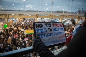 Protesters gather at JFK International Airport against Donald Trump's executive order on January 28, 2017 in New York. (Credit: Bryan R. Smith/AFP/Getty Images)