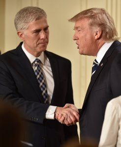 U.S. Circuit Judge Neil Gorsuch shakes hands with President Donald Trump after he was nominated for the Supreme Court, at the White House in Washington, D.C., on Jan. 31, 2017. (Credit: NICHOLAS KAMM/AFP/Getty Images)