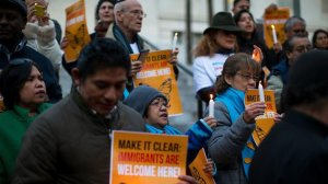 About 60 protesters attend a vigil against President Donald Trump's executive orders on immigration organized by the Coalition for Humane Immigration Rights on Jan. 25, 2017, at City Hall. (Credit: Gina Ferazzi / Los Angeles Times)