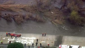 LAFD rescuers work to help a man stranded on an island in the middle of the Los Angeles River on Jan. 5, 2017. (Credit: KTLA)