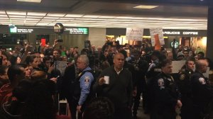Sen. Cory Booker speaks to protesters at Washington Dulles International Airport demonstrate against Pres. Trump's travel ban. (Credit: CNN)