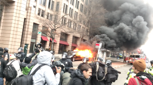 A limo was set on fire during protests in Washington, D.C., on Inauguration Day, Jan. 20, 2017. (Credit: Christina Pascucci / KTLA)