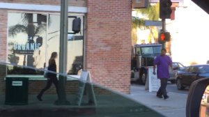 The man in purple was captured on video apparently stabbing at a woman in Hollywood on Jan. 31, 2017. (Credit: Rio)