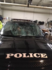 The City of Menasha Police Department shared this photo of a patrol car with a broken windshield after a man belly-flopped onto its hood on Dec. 31, 2016.