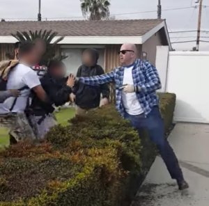 Cellphone video recorded by a witness shows an altercation between an off-duty LAPD officer, right, and teens in Anaheim on Feb. 22, 2017.