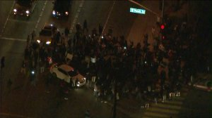Hundreds of people gathered in Anaheim on Wednesday, Feb. 22, 2017 to protest an off-duty LAPD officer firing his weapon during a struggle with a teen. (Credit: KTLA)