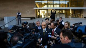 Former Los Angeles County Sheriff Lee Baca, center, talks to reporters outside court in December. (Credit: Marcus Yam/Los Angeles Times)