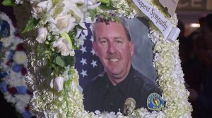 Officer Keith Boyer is shown in a photo displayed at a vigil for him outside the Whittier Police Department on Feb. 20, 2017. (Credit: KTLA)