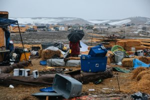 Campers prepare for the Army Corp's 2pm deadline to leave the Oceti Sakowin protest camp on February 22, 2017 in Cannon Ball, North Dakota. Activists and protesters have occupied the Standing Rock Sioux reservation for months in opposition to the completion of the Dakota Access Pipeline. (Credit: Stephen Yang/Getty Images)