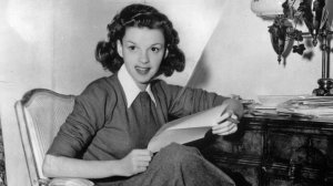 American film actress Judy Garland at home answering fan mail in 1944. (Credit: Hulton Archive / Getty Images)