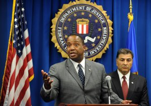 U.S. Attorney Andre Birotte Jr., left, and Steven Martinez, Assistant Director of the FBI in Los Angeles speak to reporters on Dec. 14, 2010, in Los Angeles during a press conference. (Credit: GABRIEL BOUYS/AFP/Getty Images)