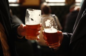 Drinkers enjoy a pint in a pub on March 11, 2011, in London, England. (Credit: Peter Macdiarmid / Getty Images)