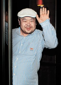 In a picture taken on June 4, 2010 Kim Jong-Nam, the eldest son of North Korean leader Kim Jong-Il, waves after an interview with South Korean media representatives in Macau. (Credit: JoongAng Sunday/AFP/Getty Images)