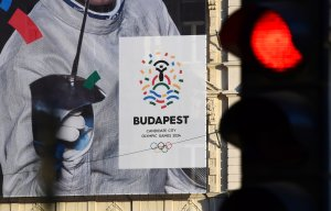 This picture taken on Jan. 17, 2017 in Budapest shows a poster of Hungarian Olympian Aron Szilagyi advertising Budapest's bid to host the 2024 Olympic Games. (Credit: Attila Kisbenedek / AFP / Getty Images)